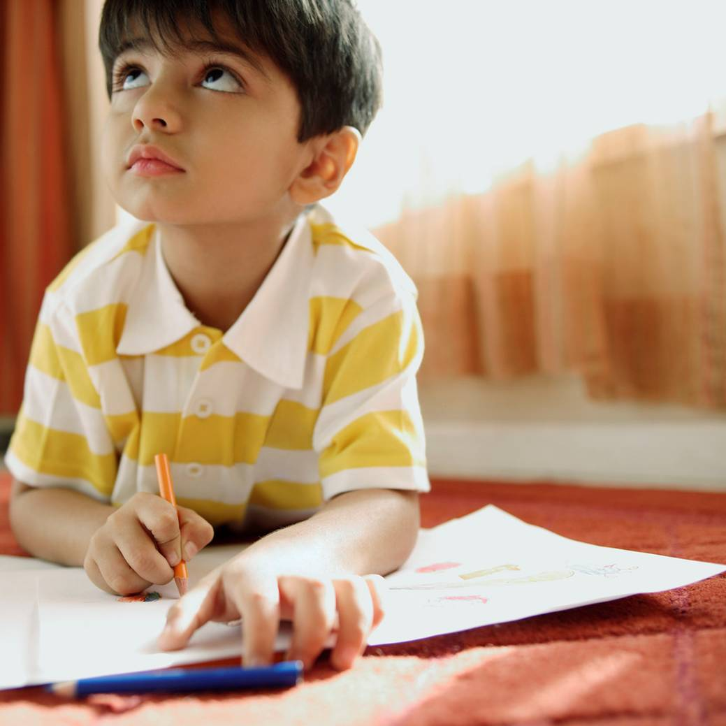 Little boy drawing with crayon